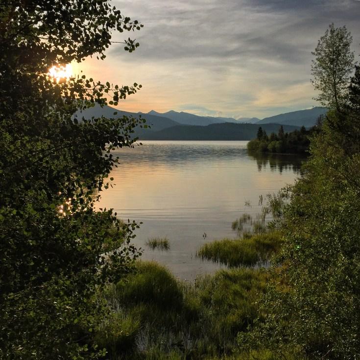 Serene summer sunrise over Dillon Reservoir.