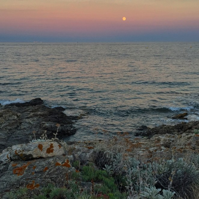 July's full moon rising above the Mediterranean.