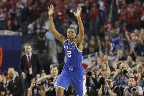 Aaron Harrison after scoring the three to drop Wisconsin