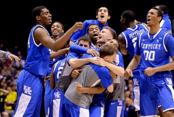 UK Celebrates after victory over Wisconsin in final seconds