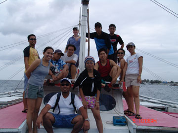 "On a boat off of Mactan Island in the Philippines with ""Team Higante"", the crew I was training in 2006"