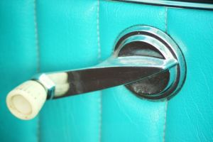 A car window handle from the 1960s