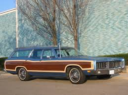 A Ford Country Squire similar to the one we had (see the photo above with me in it)