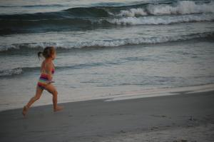 Young Lyla scampers along the beach in Maine in September 2015