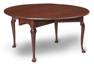oval dining table with curved legs and triffid feet