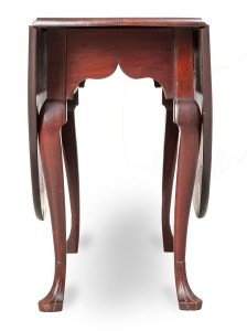 end view of table with curved legs and Gothic arch in skirt