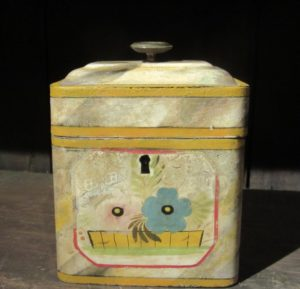tin box with painted flowers