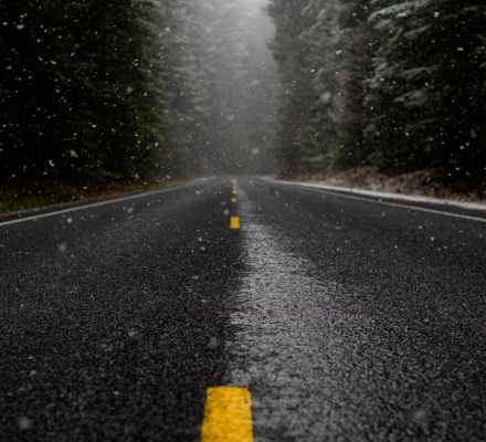 low angle photo of road while raining