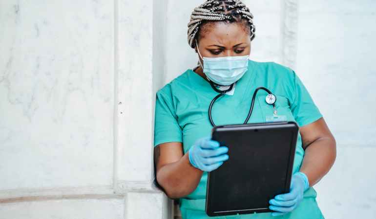 focused woman with documents in hospital