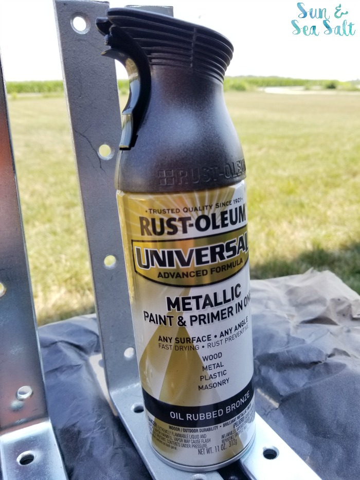 Rustoleum Metallic Spray Paint and Primer helped to transform ugly corner braces into rustic shelf brackets