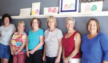 Displayed on the shelf above their heads are the first paintings done by new watercolor artists. Cindy Cisco on the far left had joined the class that day working on another project that isn't pictured. To the right of Cindy are Jean Mitchel, Judy Ramberger, Sonia Sjurseth, Jean Pritchert and Carolyn Hanson.