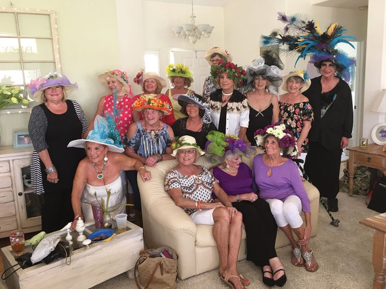 Ladies decorated straw hats for prizes at Kentucky Derby innovative party.
