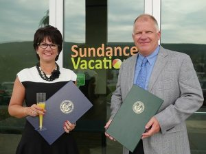 Sundance Vacations Co-Founders Accept Senate Citation for Company Milestone