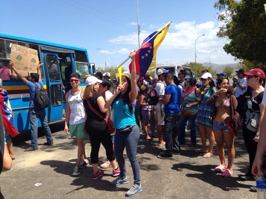 La femme de Carlos, lors d'une manifestation anti-Chavez.