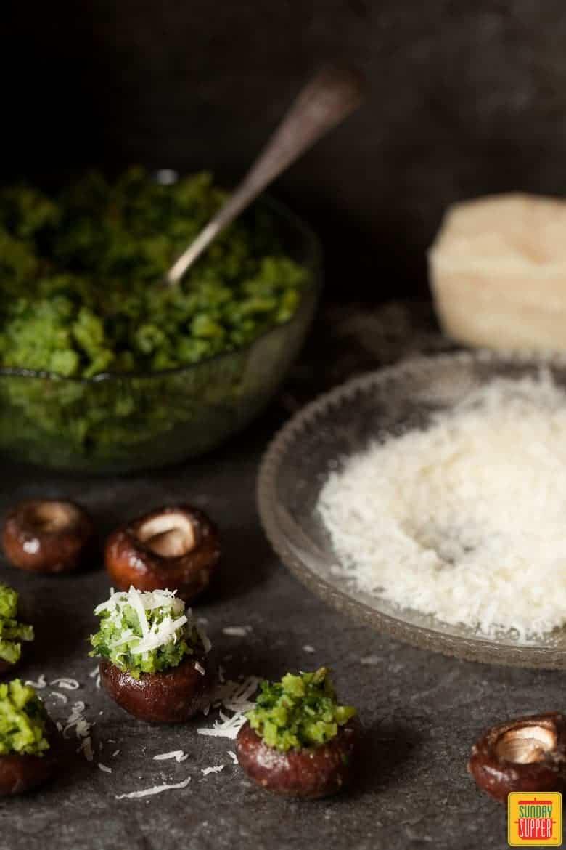 Vegetarian Stuffed Mushroom Recipe being stuffed and ready to bake