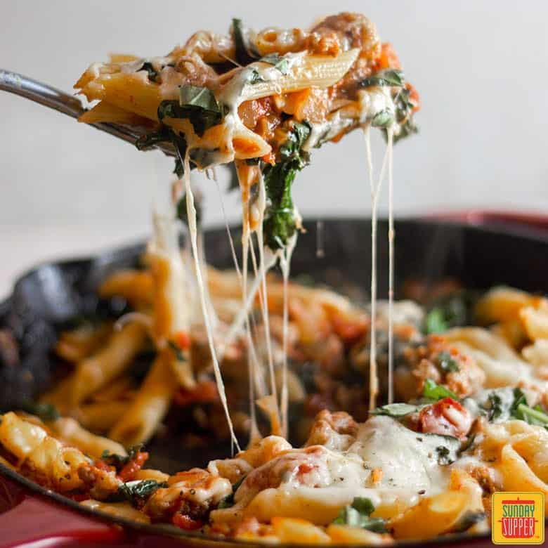 Big cheesy spoonful of Sausage and Kale Pasta Bake