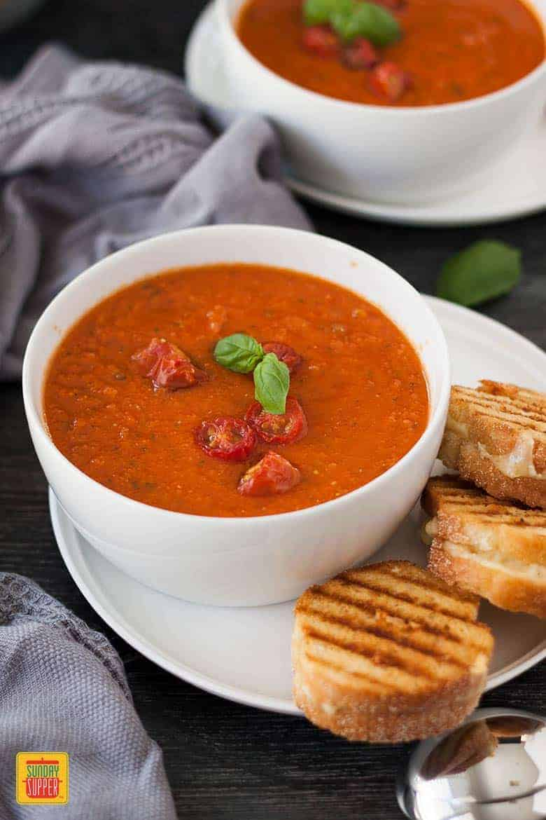 Mini Grilled Cheese sandwiches and a bowl of Roasted Tomato Soup