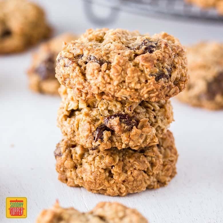 Gluten Free Oatmeal Raisin cookies stacked 3 high and ready to enjoy!