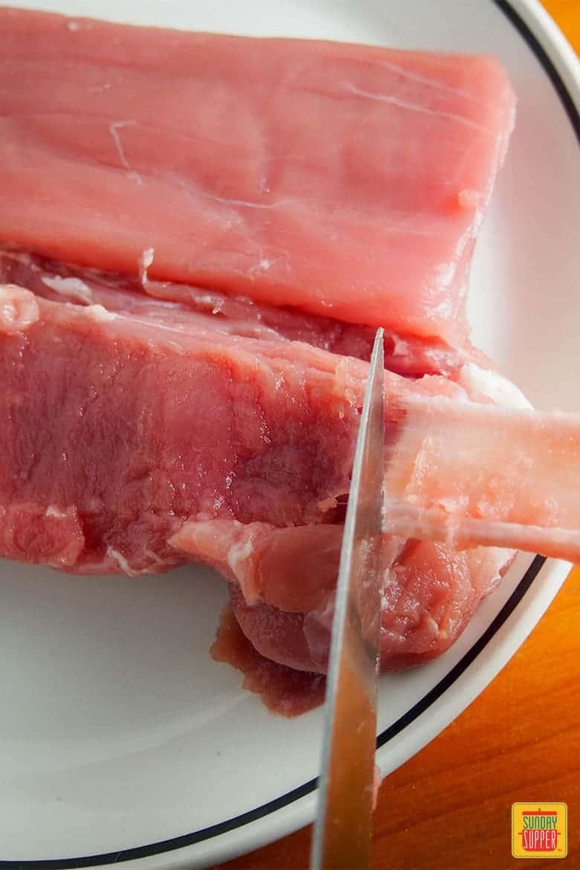 pork tenderloin with rhubarb chutney - trimming the pork