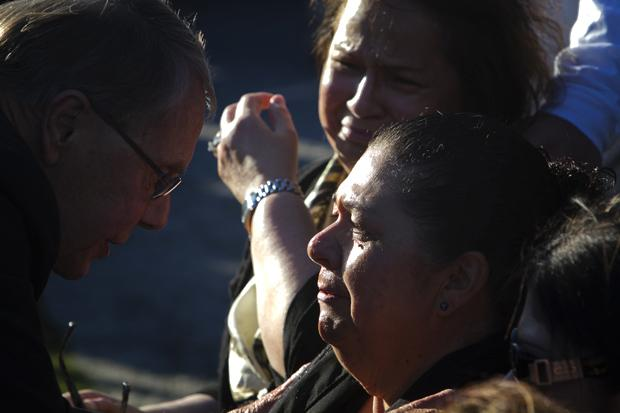 Family members mourn the loss of 26-year old Marcela Franco and her father Carlos Franco at a memorial for the victims of the Santa Monica shooting. Photo credit: Charlie Kaijo / Senior Photographer