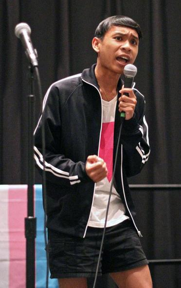 "Sophomore humanities major and queer studies minor, Timothy Nang performs poetry during the ""T is No Longer Silent"" event at the Northridge Center, USU on Thursday evening. Photo credit: Lucas Esposito / Daily Sundial"