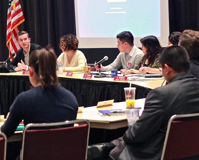 Associated Student president Christopher Woolett talks to other members of AS about the proposed $2 student fee for the California State Student Association