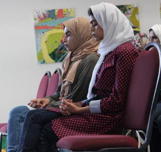 Ebtehal Alrecucaily, 27, and Fatimah Hakeem, 27, family friends of Ahmed Alkadi, attended Abdullah Alkadi's memorial gathering held at CSUN on Oct. 21. Hakeem played audio of the Quran as people walked into the memorial.