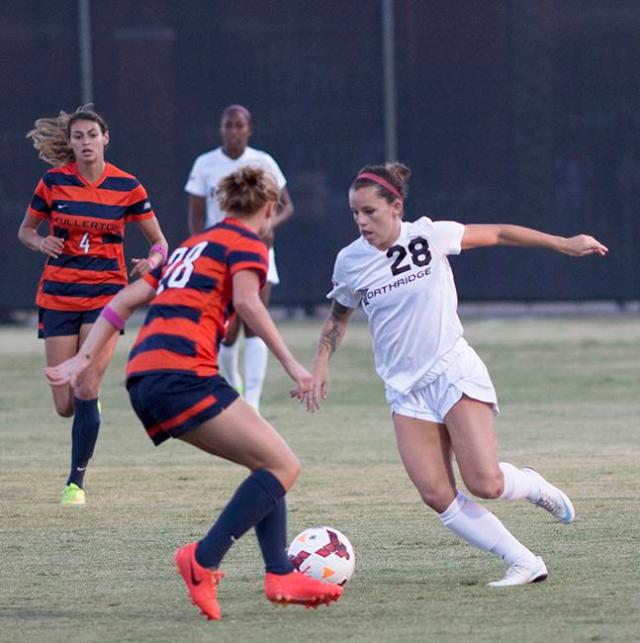 Junior Lyndsey Preston looks for a way past Cal State Fullerton's Colleen Ortega during the Matadors' match on Oct. 19, 2014. The Matadors fell to the Titans, 1-0, suffering their first loss in the Big West Conference. Photo Credit: Trevor Stamp/ Senior Photographer