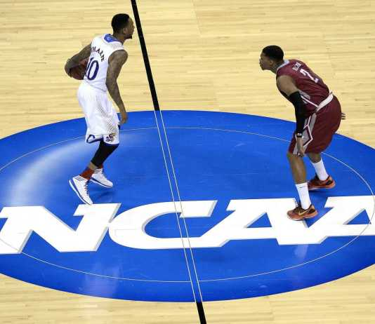 Basketball opponents play one-on-one