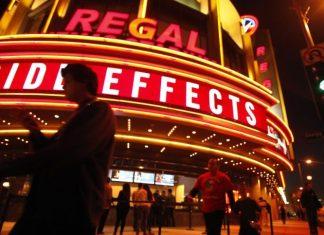 People walk outside Regal Theater