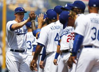 The dodgers high-five each other