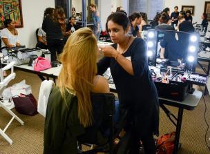 Woman does model's makeup