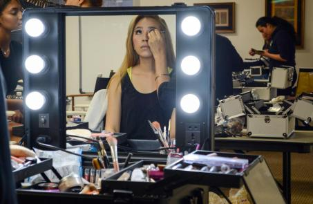 Model waits as her makeup is done before show