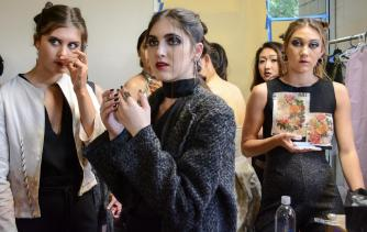 Models wait backstage before runway show