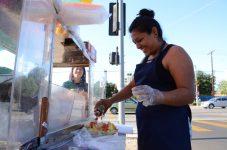 vendor puts finishing touches on fruit tray
