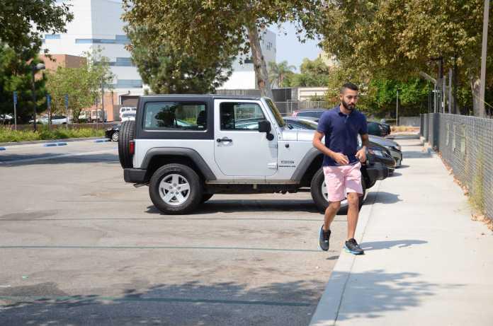 Man walks away from car after parking