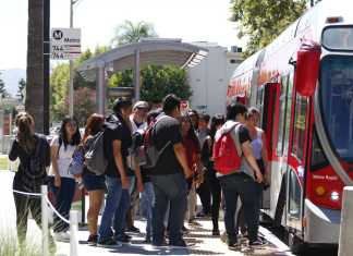 Students board the city bus