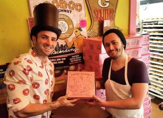 man poses with voodoo doughnut employee