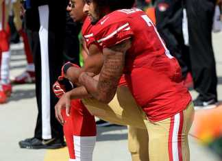 football players kneel
