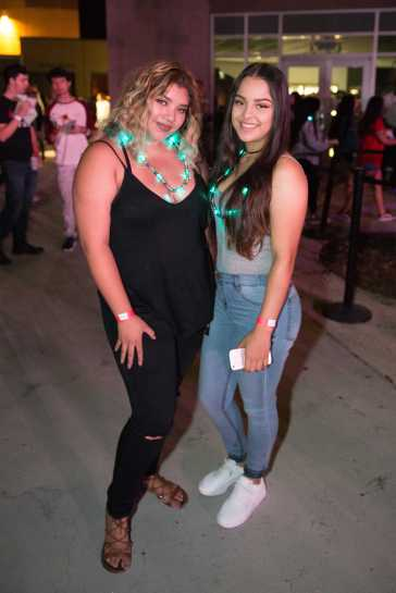 2 students pictured wearing light up necklaces at matador nights