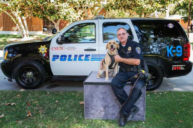 Police officer poses with police dog