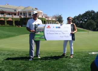 Duffy Waldorf presents a $10,000 check to Stephanie Hunter
