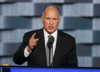 Jerry Brown speaks at podium