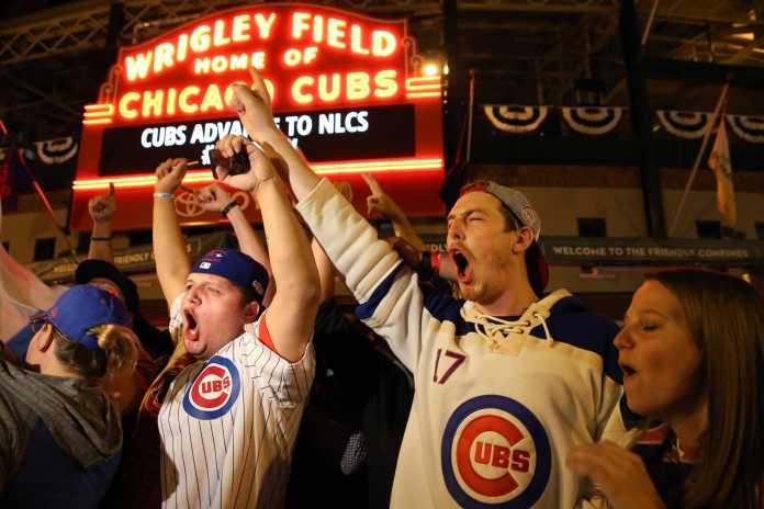 Chicago Cub fans gather outside Wrigley Field