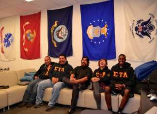 Members of Sigma Tau Alpha pose for a picture in the VRC