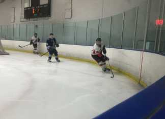 Hockey players circle their zone