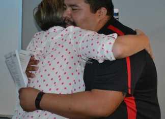 Marine veteran hugs CSUN faculty member