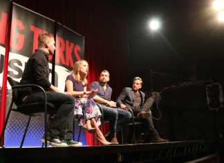 Ana Kasparian is shown in the middle of a discussion at The Young Turks panel