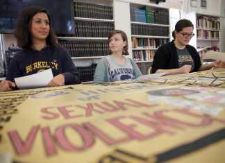 Students shown alongside sexual violence poster