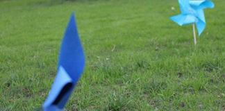 Two blue pinwheels are shown on the Oviatt Lawn